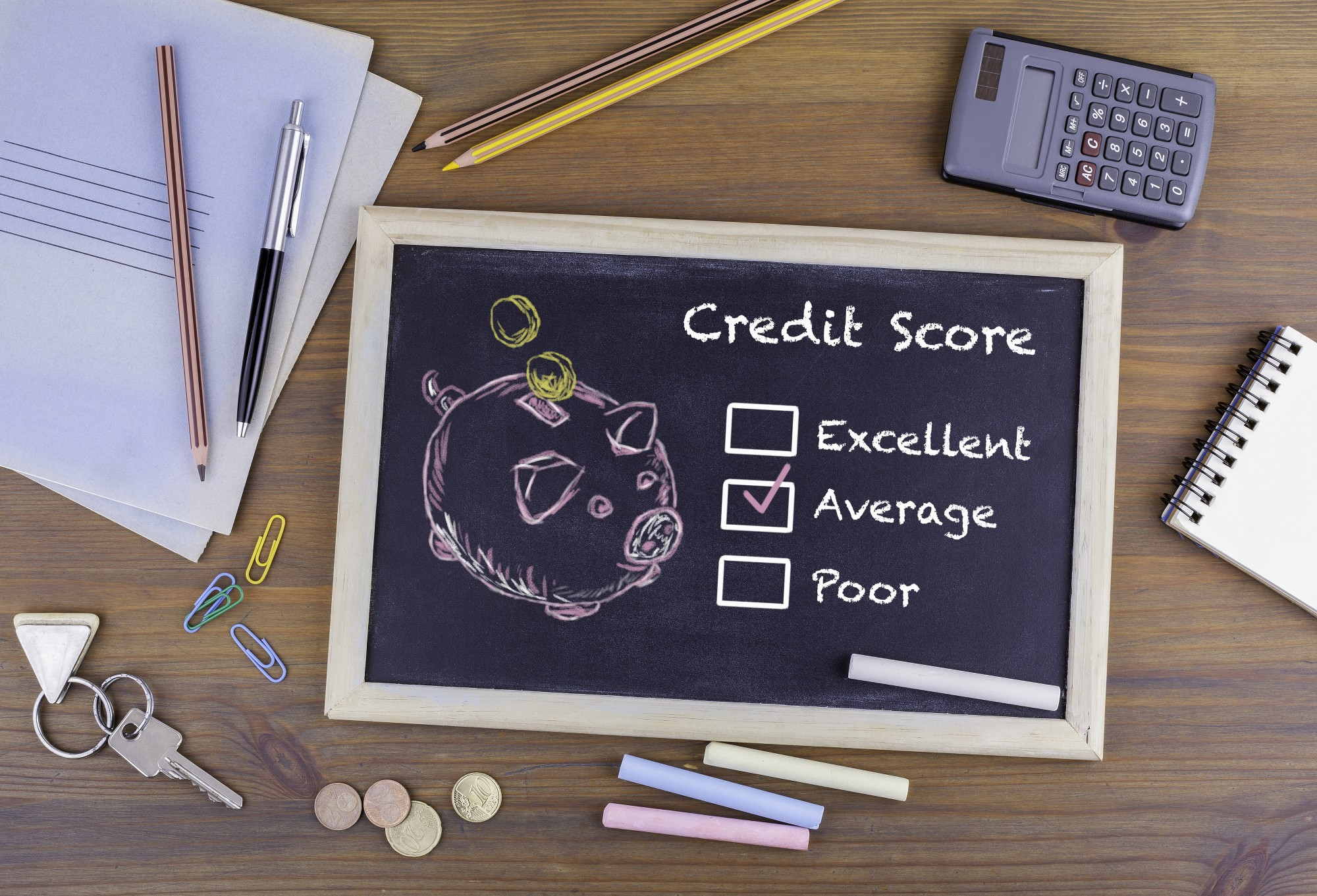 Average Credit Score concept. Chalkboard on wooden office desk